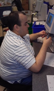 Jeffrey uses the Lensometer to determine the prescription of the glasses.